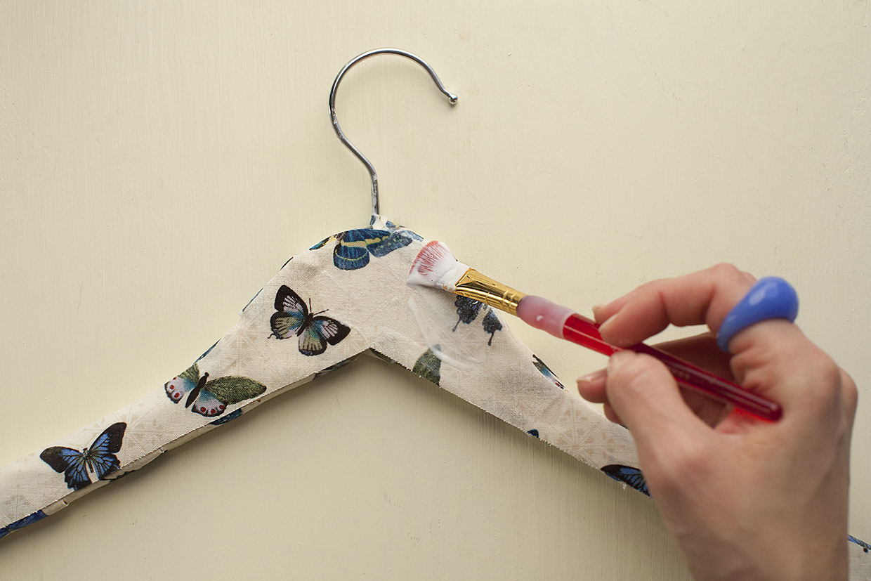 Fabric decoupaged coat hangers maker crate for Coat hanger art projects